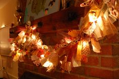 Thanksgiving/Fall garland made with strips of fabric, tulle, lace on a string of Christmas lights.  It was easy!