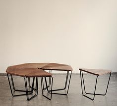 Modular tables - multiple triangles can be rearranged and assembled in whatever shape required. Minimalist. D