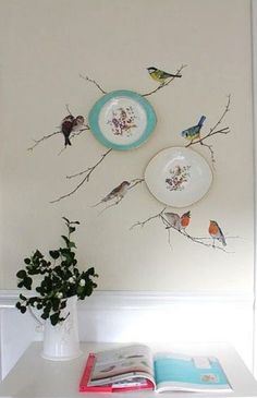 A very creative way to add interest to plates hanging on the wall.