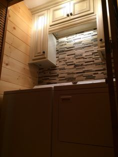 before and after log cabin small laundry room upgrade antique white
