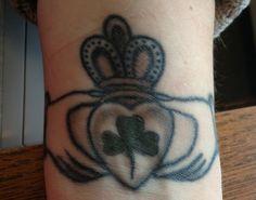 Wrist tattoo- claddagh and shamrock- friendship loyalty and love