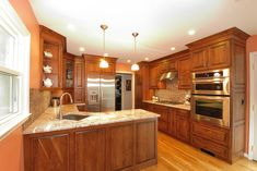 A small kitchen that has all the conveniences of a larger space including a warming drawer and trash compactor.