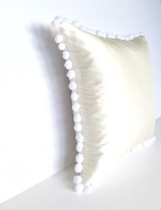 Ivory Silk White Pom Pom Square Cotswold Cushion - Angle