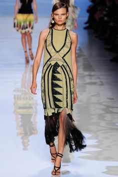 This dress displays patterns of art nouveau. It is from the Eter Springsumm S/S 2012 collection. Art nouveau influenced a fluid silhouette for women with organic qualities and exotic characteristics.