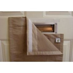 Mail slot cover keeps icy air out in winter plus dog doesn't eat the mail