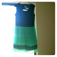Cute dress Very cute flowie dress perfect for the summer with a little back showing I am 5'4 to 5'5 and it fits to my knees sweet storm Dresses