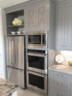 Stunning gray kitchen cabinets with french door refrigerator, farmhouse style ac. Stunning gray kitchen cabinets with french door refrigerator, farmhouse style accent cabinets, a built-in microwave, and a double in-wall oven Cottage Kitchen Cabinets, Diy Kitchen, Kitchen Decor, Kitchen Counters, Gray Kitchen Walls, Cheap Kitchen, Built In Kitchen Appliances, Kitchen Cabinetry, Kitchen Islands