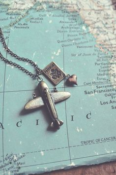 This is one of my favorite necklaces, because, well, I absolutely love to travel! An antiqued brass airplane, a little passport and a copper heart Little Passports, Wanderlust, Sport Chic, Adventure Is Out There, Messing, Jewelry Accessories, Hipster Accessories, Jewlery, Bling