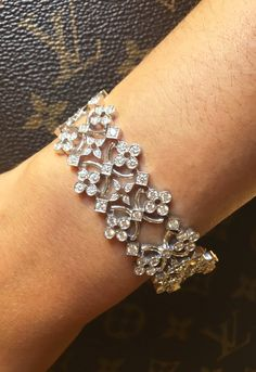 Louis Vuitton Dentelle de Monogram bracelet with diamonds set in white gold to recreate the delicate pattern of lace.