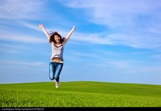 Young beautiful woman jumping for joy - stock photo