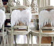 angel wings here, but I would LOVE butterfly and even fairy wings for the backs of my chairs, especially for parties!