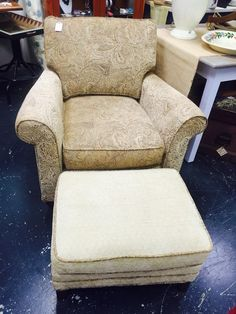 Upholstered chair and ottoman.