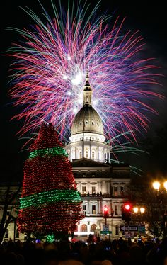 Fireworks explode over the State Capitol Building in Lansing, MI Holiday Lights, Christmas Lights, Christmas Trees, Winter Christmas, Christmas Decorations, Christmas In The City, Fire Works, Michigan Travel, Tree Lighting