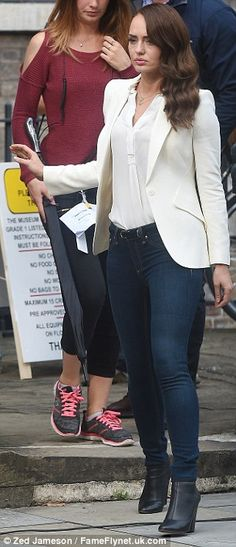A quick change: Later on in the day the actress changed into a white blazer and blouse, which she paired with skinny jeans and high-heeled boots
