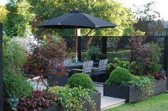 Ide til tilplantning af plantekasser ved terrasse