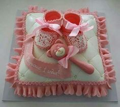 Rattle, booties on Pillow cake