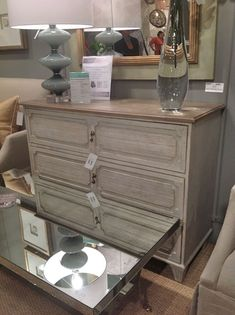 The Gabriella Chest, with a Toscana Parisian Gray finish and a Toscana Chocolate Mousse Top. The drop pulls are a charming detail.