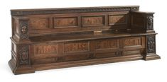 An Italian Renaissance carved walnut and fruitwood marquetry cassapanca incorporating 16th century elements