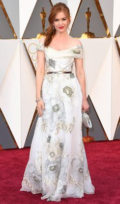 The Best Oscars Gowns of 2016 // ISLA FISHER picks a super-romantic floral print ivory Marchesa gown with a silver belt, Salvatore Ferragamo clutch and dainty Norman Silverman jewels.