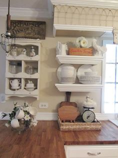 "Junk Chic Cottage- wire light fixture, garden fence on sofit adds texture, vintage scales make anything better, butcherblock countertop and clean white accents ""rustic & simple"""