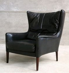 Illum Wikkelsø; Leather and Rosewood Easy Chair, 1960s.