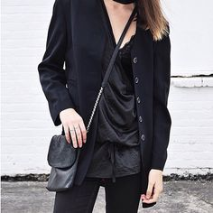 black on black outfit inspo from @iamarchive featuring the #moochi chained bag. available in store or online at moochi.co.nz