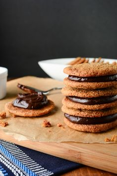 Soft and Chewy Spiced Molasses Cookies sandwich filled with Chocolate Ganache Filling. Great with a cup of tea or for holiday dessert trays!