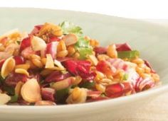 Farro Salad with Radicchio and Pomegranate: This salad can be refrigerated overnight, without the almonds, and brought to room temperature before serving.