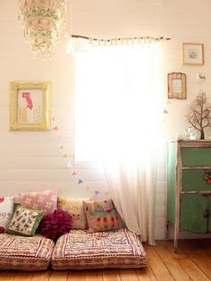 I'm sure I saw this kid's room originally on Ohdeedoh. Love everything about it. Esp the reading cushions....