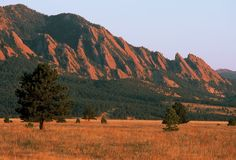 Boulder Colorado | Late summer sunrise on the Flatirons, near Boulder, Colorado