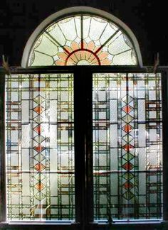 Geometric stained glass overlay with arch.
