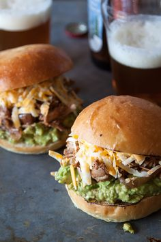 Shredded BBQ Chicken Burgers with Guacamole - SUPER easy and were so delish! They were a hit with our guests.