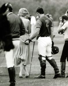 Prince Charles pinches Diana's bottom at the Polo at Windsor Great Park in June 1985