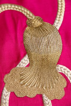 detail of an incredibly fine silver and gold embroidered tassle on a hot pink Japanese obi ,   collection Carolina Breuer