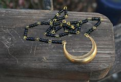 Gold Crescent Necklace with Black Beaded Chain handmade gift by practicallyfrivolous on Etsy