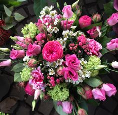 Pink bouquet with piano roses, lisianthus, wax flower, vibernum and carnations
