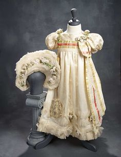 """What Finespun Threads"" - Antique Doll Costumes, 1840-1925 - March 12, 2017: 171 Luxurious Ivory Silk Satin Gown with Fan and Matching Bonnet"