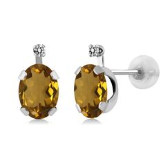 1.41 Ct Oval Whiskey Quartz White Diamond 14K White Gold Earrings. This item is proudly custom made in the USA. 100% Satisfaction Guaranteed. Gemstones may have been treated to improve their appearance or durability and may require special care.