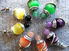 This colorful earrings are on sale on my etsy shop. Limited time offer!  https://www.etsy.com/es/listing/235113101/on-sale-orange-yellow-purple-green