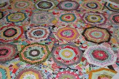 This gorgeous spiderweb quilt was made by Megan. You can see more photos on her blog: Lucy and Norman . She was inspired by a quilt cal...