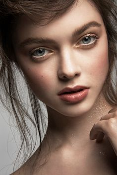 I love the natural makeup tones. The crop and lighting are also very simple and beautiful.   This is a very inspiring image for this shoot.