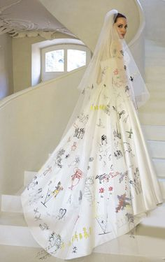Angelina Jolie's Official Versace wedding dress & veil were decorated with her children's artwork.