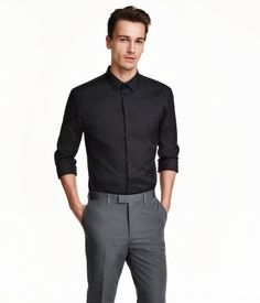 Long-sleeved shirt in a stretch cotton blend with a narrow turn-down collar. Tailored with shaping seams at back. Slim fit.