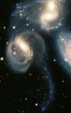 colliding galaxies...maybe they are really just boogieing with each other!  I'd love to hear that galactic rock music!