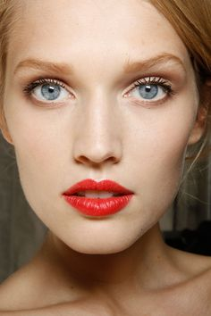 glamour done simply-- Sparse eye make up, poppy red lips.  Stronger eyeliner on top and you've almost got old Hollywood glam.