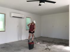 Prepping a concrete floor for paint. Garage conversion project. Painted Concrete Floors, Painting Concrete, Concrete Slab, Framing A Closet, Wood Plank Ceiling, Bathroom Accents, Custom Vanity, Bachelorette Pad, Floor Colors
