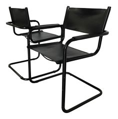 """For your consideration is a pair of vintage, mid-century modern Mart Stam S-34 cantilever chairs in black leather with a black, powder-coated aluminum tubular frame. Great as dining chairs, accent chairs, or office chairs. The flexible cantilever design makes these chairs super comfortable!  Dimensions:  23.5""""W x 22""""D x 31""""H Seat: 16.5""""W x 14.25""""D x 18.25""""H Arm Height: 24.75""""H  Excellent vintage condition with very little wear. Some light scratching on blac..."""