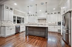 Kitchen, : Excellent Kitchen Design With White U Shaped Kitchen Cabinet Plus Grey Kitchen Island And Chic Hanging Lamp Complete With Fridge And Combine With Brown Wood Laminate Floor