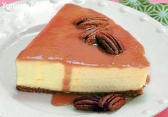 Vanilla Bean Cheesecake with Caramel Rum Sauce