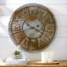 Sundials, while possessing an inherent gracefulness, aren't the most convenient way to tell the time. We've combined the elegance of ancient timekeeping with an easy-to-read oversized clock in an industrial design. Crafted of wrought iron in a galvanized pewter finish, it's a distinguished yet practical accent for a living room or family room.